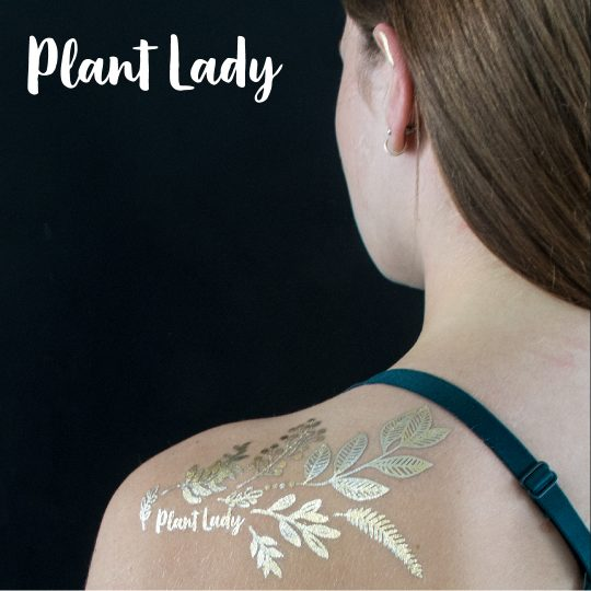 Golden temporary tattoo design. Plant Lady. Photo