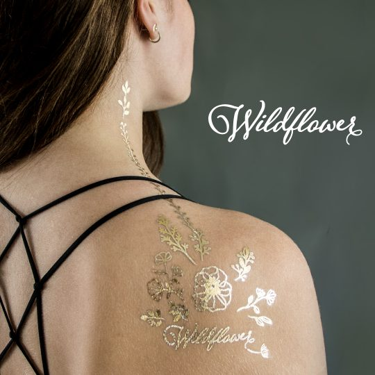 Golden temporary tattoo design. Wildflower. Photo