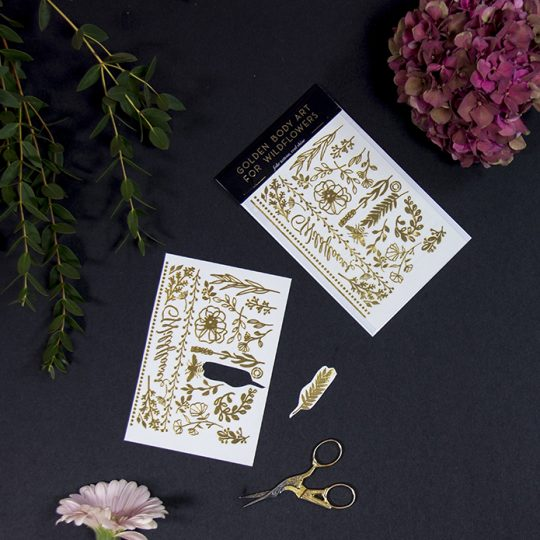 Selection of golden temporary tattoos. Photo